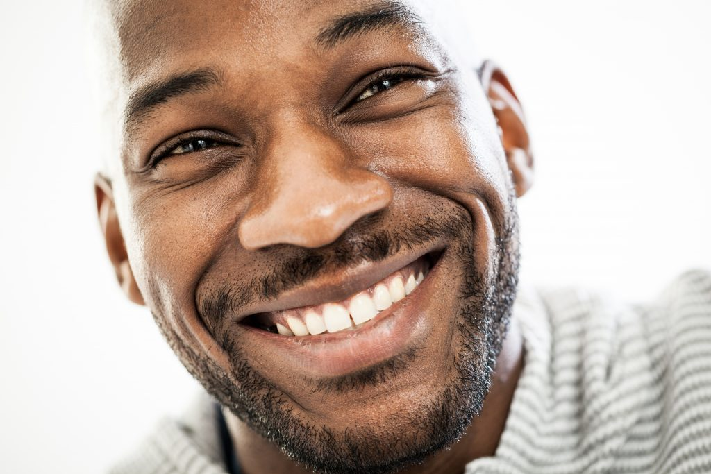 Close up of a black man with a beautiful smile.